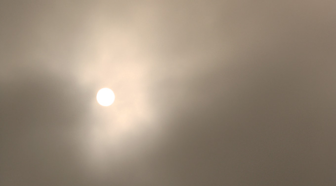 sun breaking through the fog, sepia